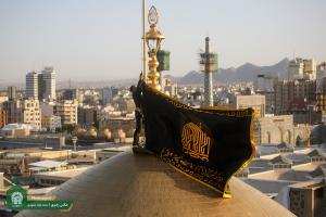 AQR hoists black flag over the shrine's dome as sign of mourning for Imam Hussein (AS)