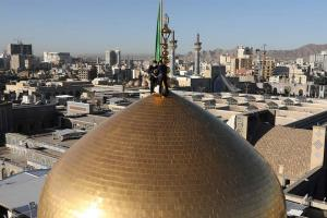 Changing dome flag ritual was held at holy shrine